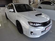 2011 Subaru WRX STI 4-door - Front 3/4