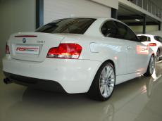 2010 BMW 135i Sport Coupe DCT - Rear 3/4