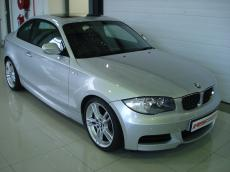 2010 BMW 135i M-Sport Coupe (M/T) - Front 3/4