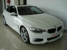 2015 BMW 435i Coupe M Sport A/T (F32) - Front 3/4