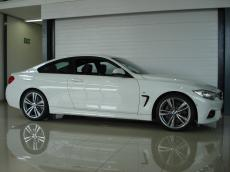2015 BMW 435i Coupe M Sport A/T (F32) - Side