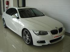2012 BMW 335i Coupe M-Sport DCT - Front 3/4
